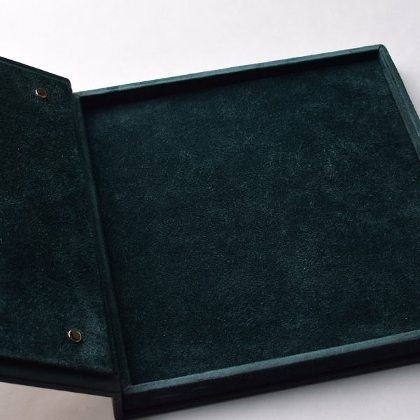 Velvet casket upholstery for storing a precious necklace. Luxurious jewelry packaging.