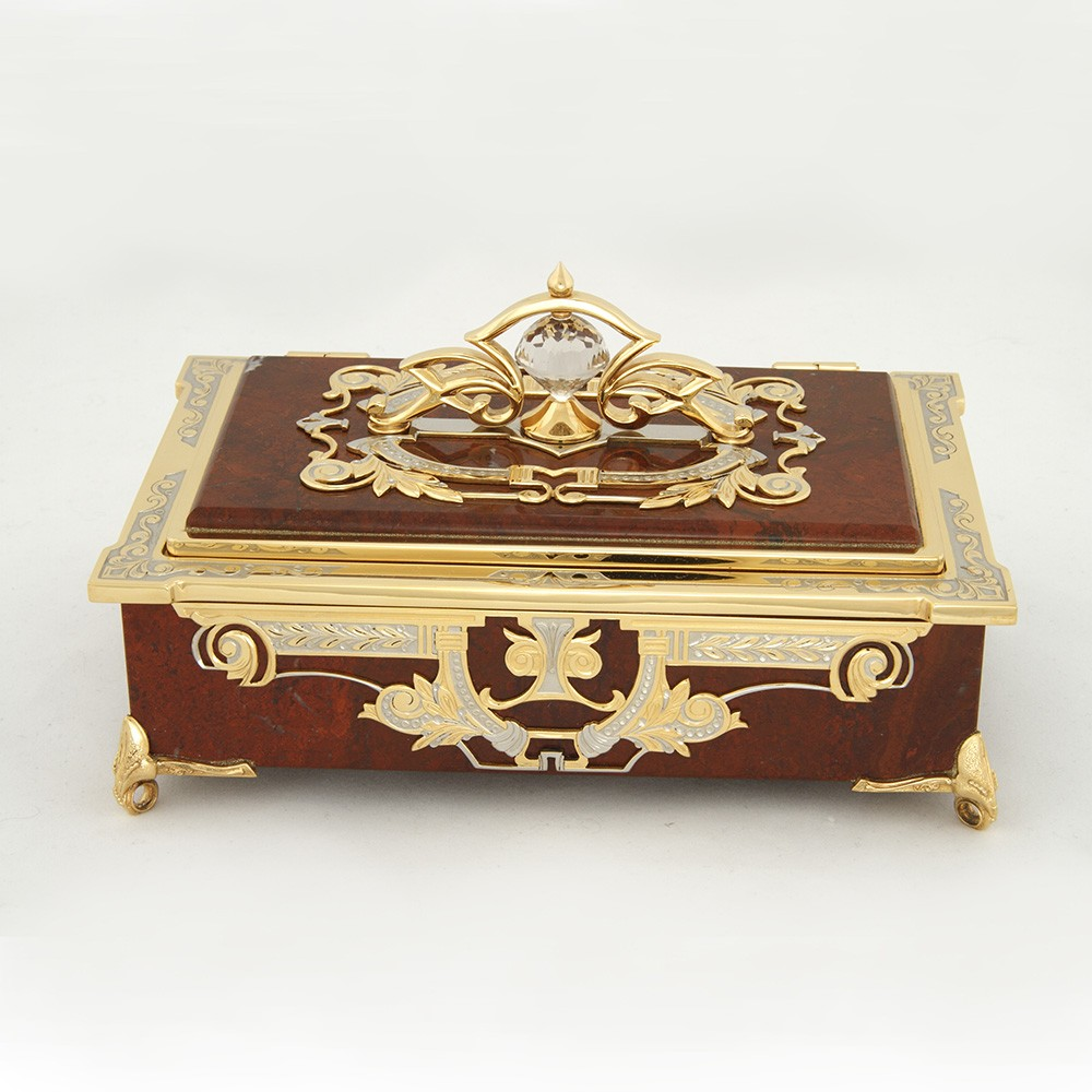 "The ""Money"" casket from the masters of Zlatoust is decorated with engraving and rock crystal. It will suit the boudoir, emphasize the status and taste of the person, will be an excellent, functional gift, reminiscent of a person who presented it."