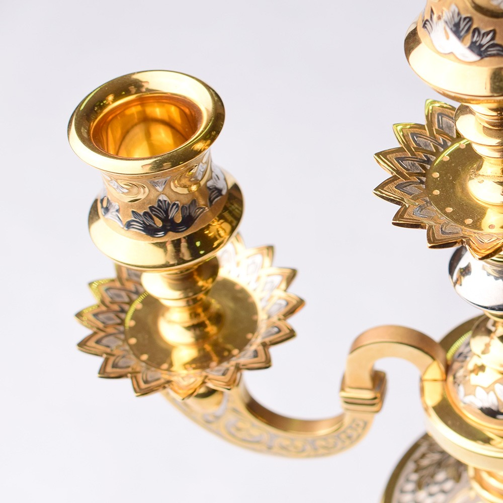 Three traditional golden candle candelabra