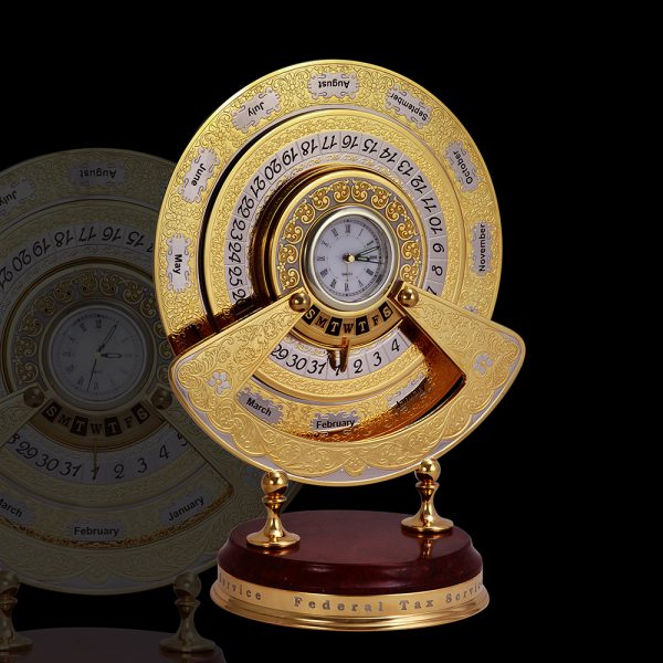 Office tools. Golden perpetual calendar for your office. Luxurious gift to the boss