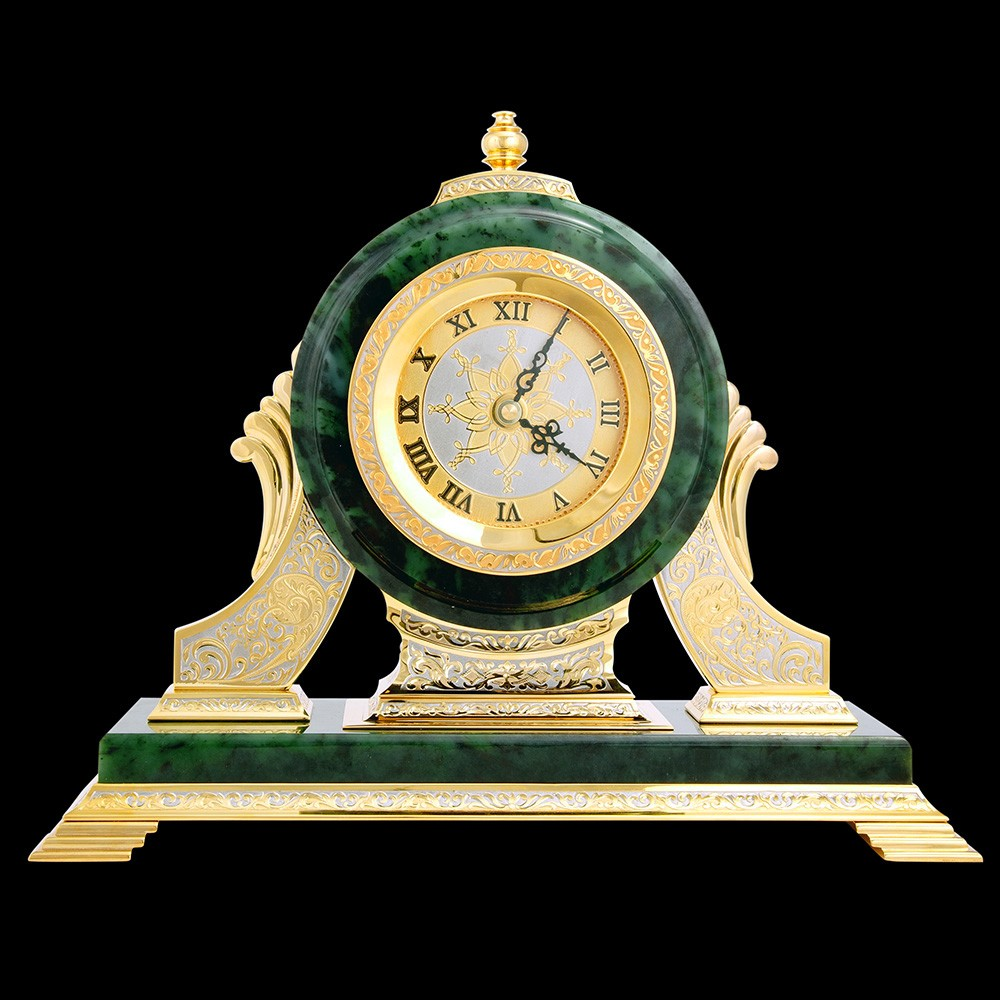 Luxurious office desktop accessory in Dubai. Jade watch with gold engraving