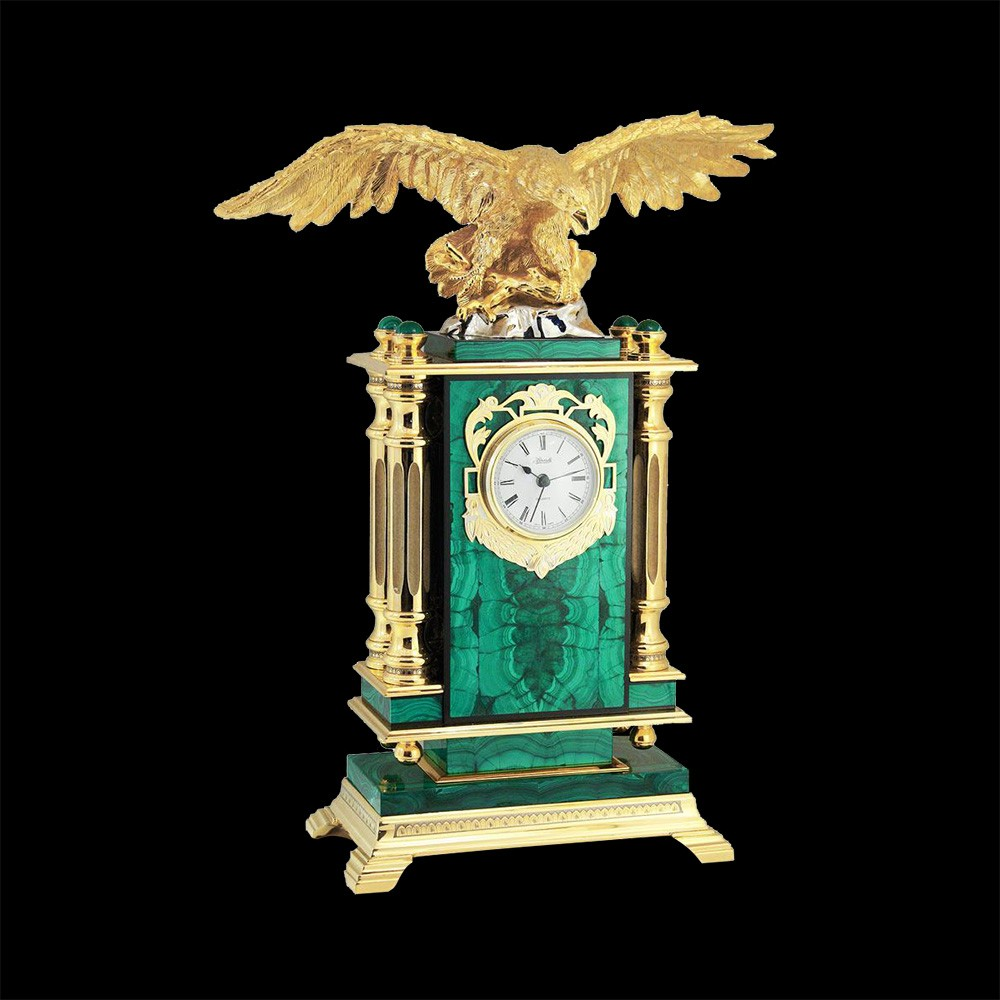 Monumentality of the clock is conveyed by a combination of simple forms of stone and classic columns. Columns made of metal have richly decorated capitals. The column surface is plated with pure gold.