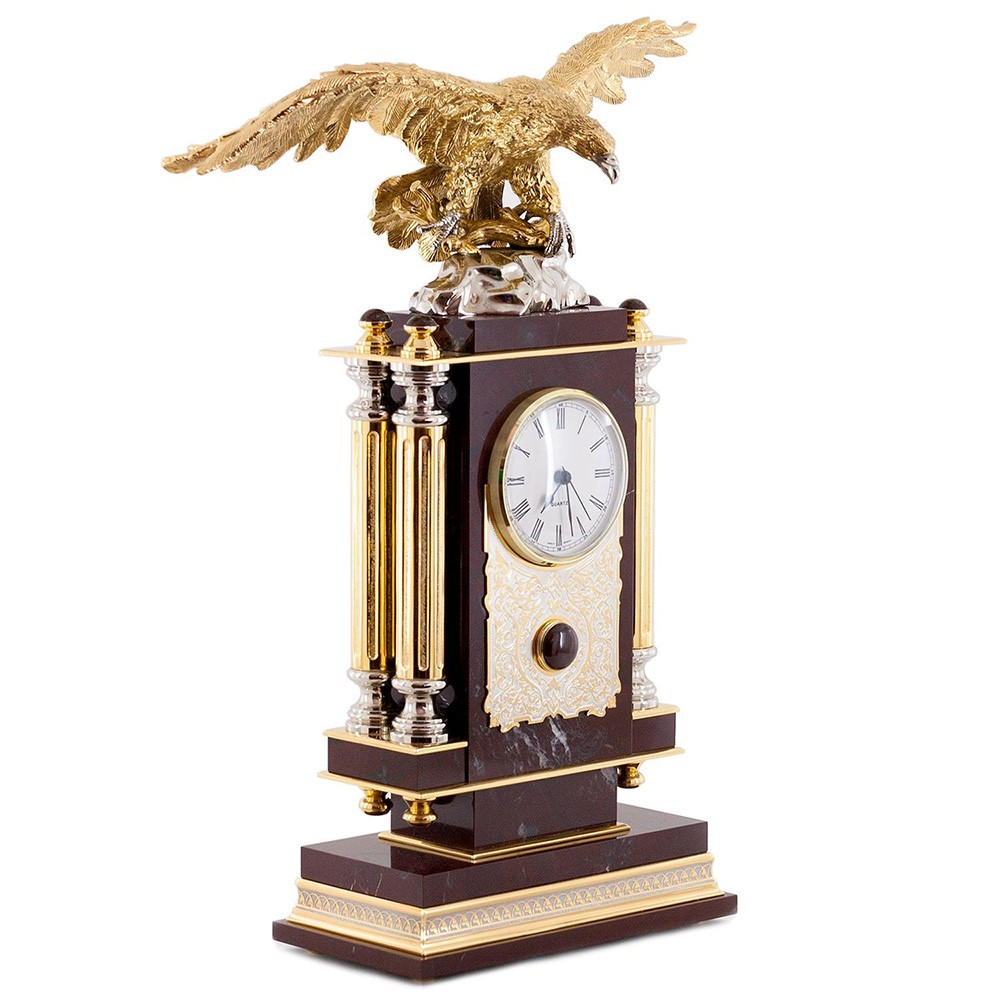 The natural mineral jasper is a stone-healer, a stone closely associated with the elements of air. The eagle, a mighty symbol of the sky, emphasizes the element of air. There are metal columns on the sides of the clock.