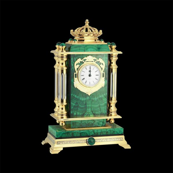 "A clock made of stone is a classic interior accessory; it is the beating heart of the interior. The ""Crown"" clock are called so for a reason. At the top of the clock on a malachite plate, there is a figured crown stylized as a real monarch crown."