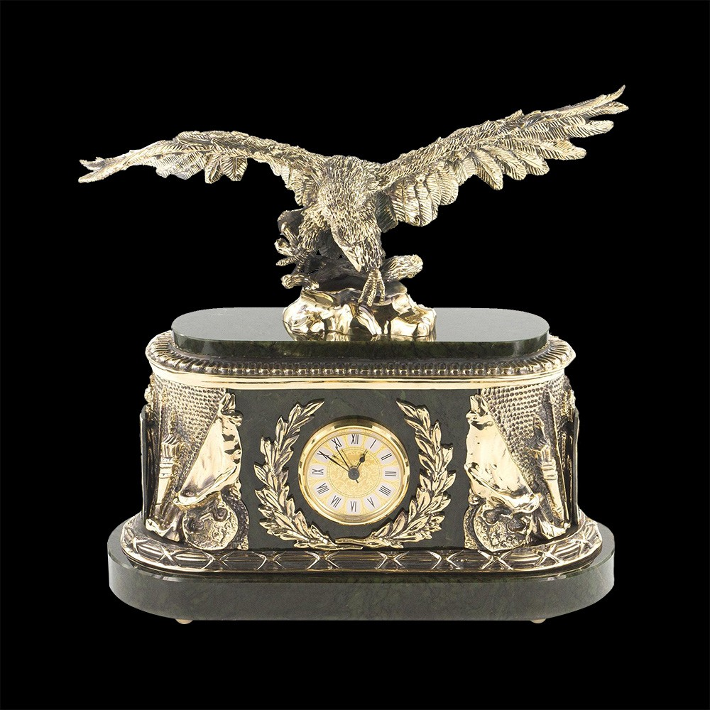 A clock with a sculpture of a feathered predator decorating the monumental case creates a place of power in the interior.