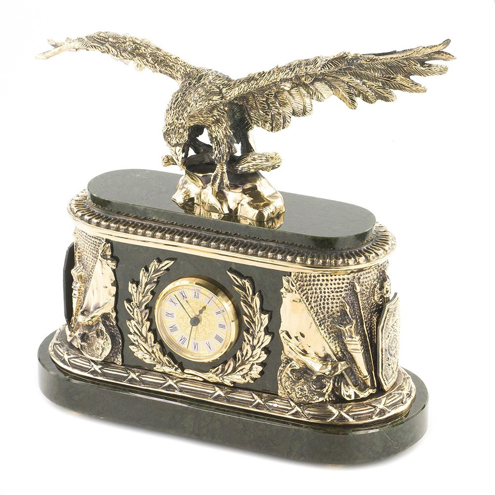 Bronze eagle on a stone rock made of natural jade. Luxury handmade clock for the fireplace.