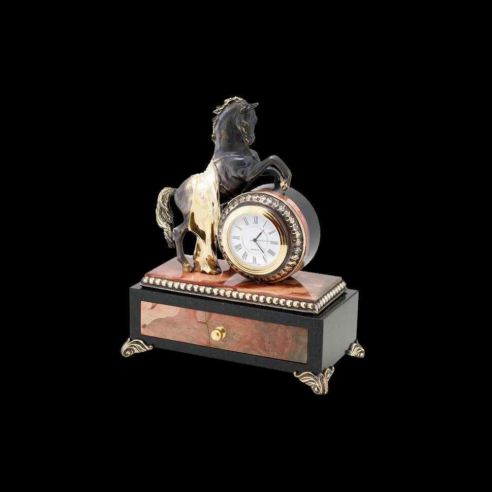 Handmade box made of natural stone. A round clock with a graceful horse is located on the casket.