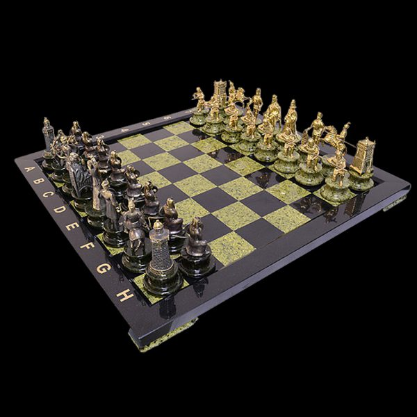 Black and green stone chess made of Ural stone. The figures are cast in brass and tinted in gold and antiquity.
