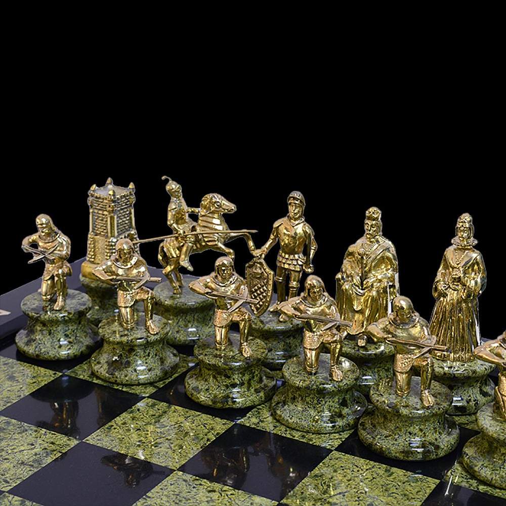 Figures of the knights on the coil. Golden king surrounded by guards from crossbowmen.