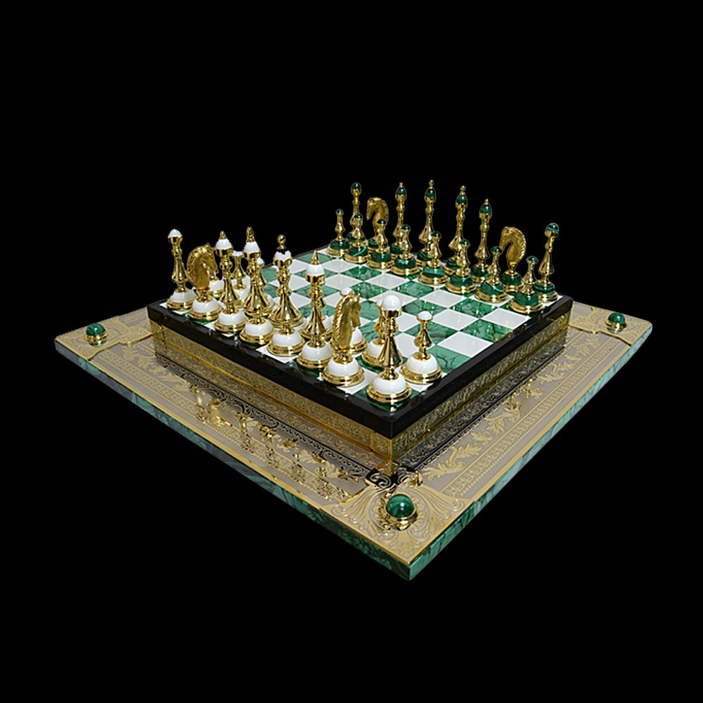 Exclusive chess made of gold and malachine. Such chess will decorate the interior of your study or living room.