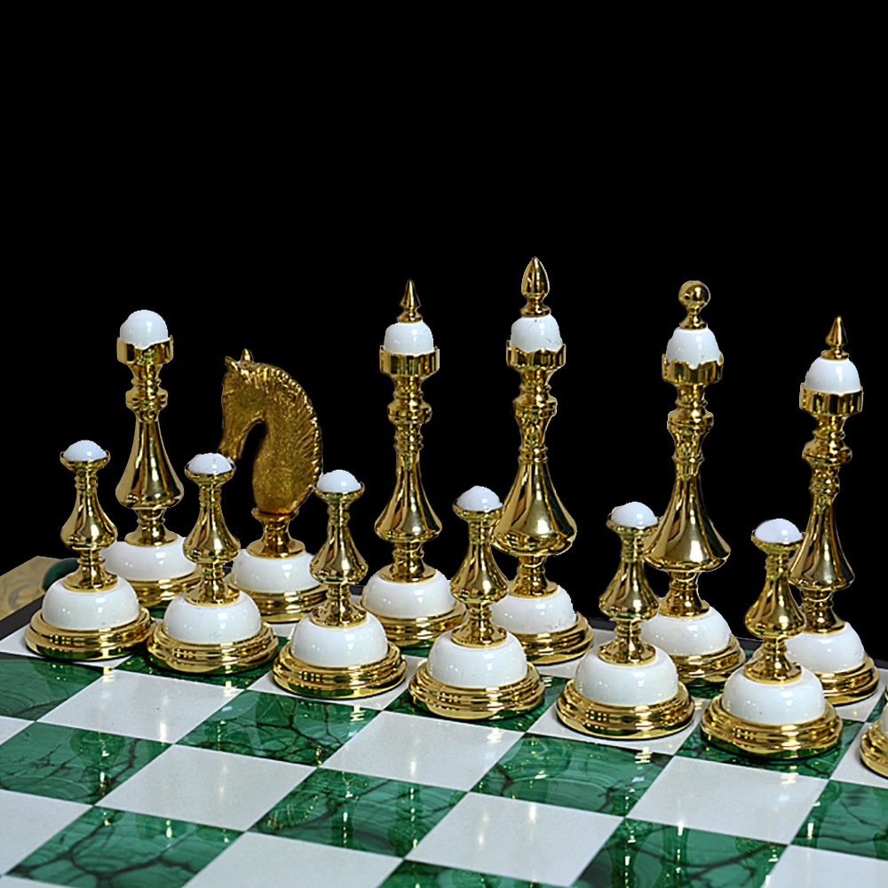 Classic chess pieces made of snow-white cacholong and gold.