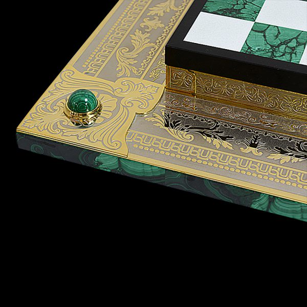 Malachite board covered with gold plates. Slips are decorated with Zlatoust engraving on metal.