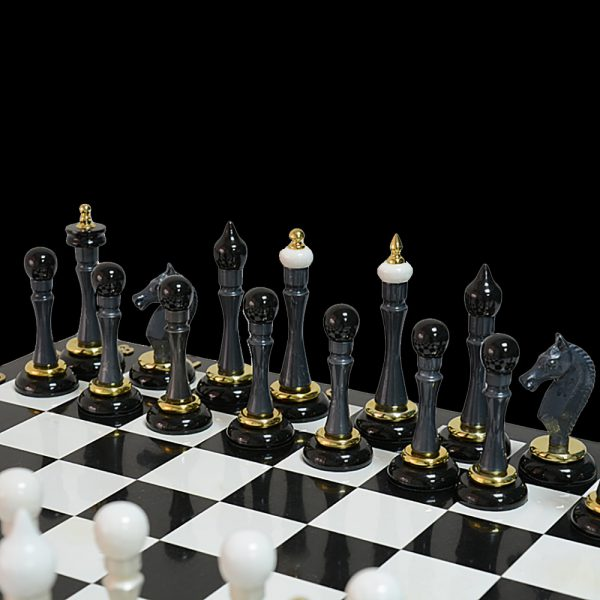 Stylish chess pieces made of black natural stone.