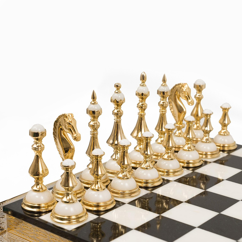 Golden chess – Classic Handmade chess is a gift, an example of interior design, the modern Zlatoust art of stone and metal treatment with artistic and collection value.