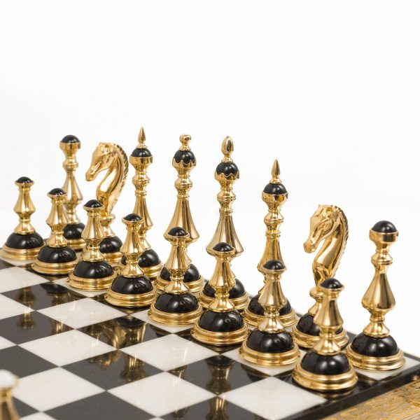 Black chess pieces made of gold and stone. A luxurious item for interior decoration.