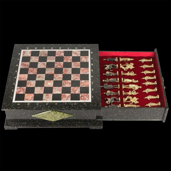 Handmade stone chess include a casket for storing pieces. On the lid, there is a playing field of red and black stone. The casket has an impressive mass of up to 30 kilograms.