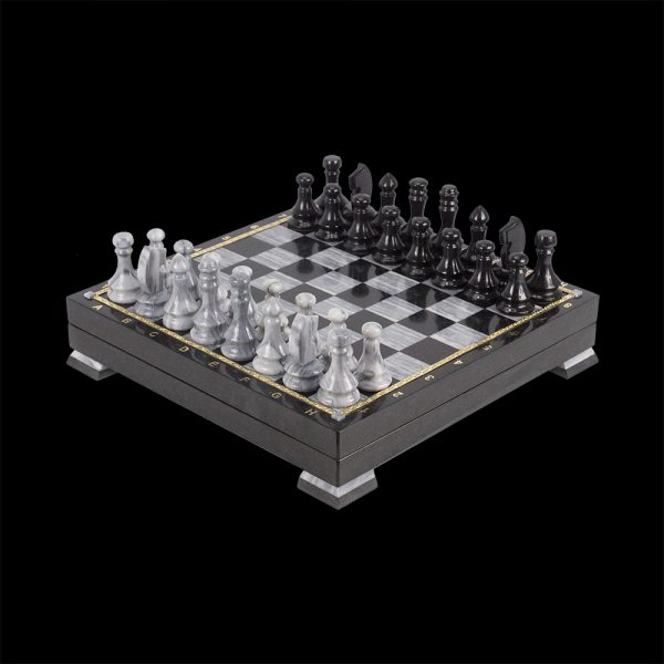 Handmade stone chess polished to a mirror shine. Cell color is black and graphite.