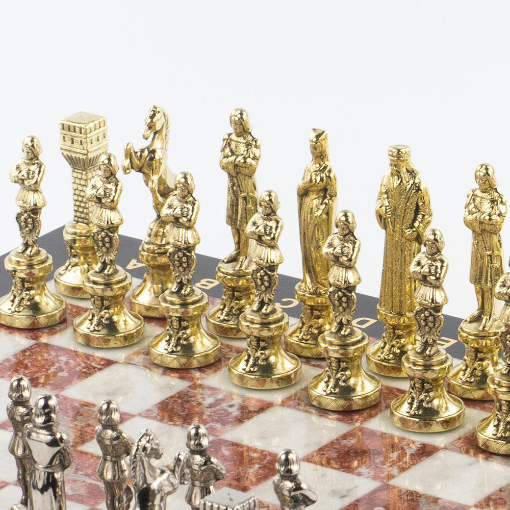 Cast chess pieces in gold plating. Luxurious corporate gift.
