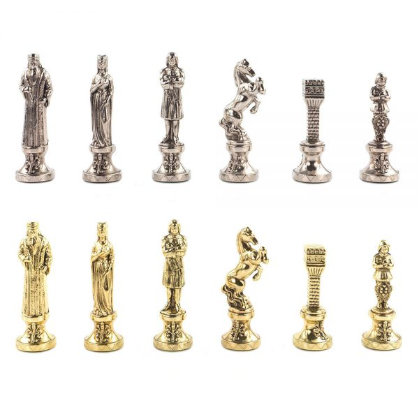 Set of chess pieces in gold and silver colors.