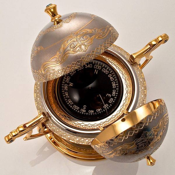 Corporate gift for the boss. The Golden compass is handmade from the President's masters.