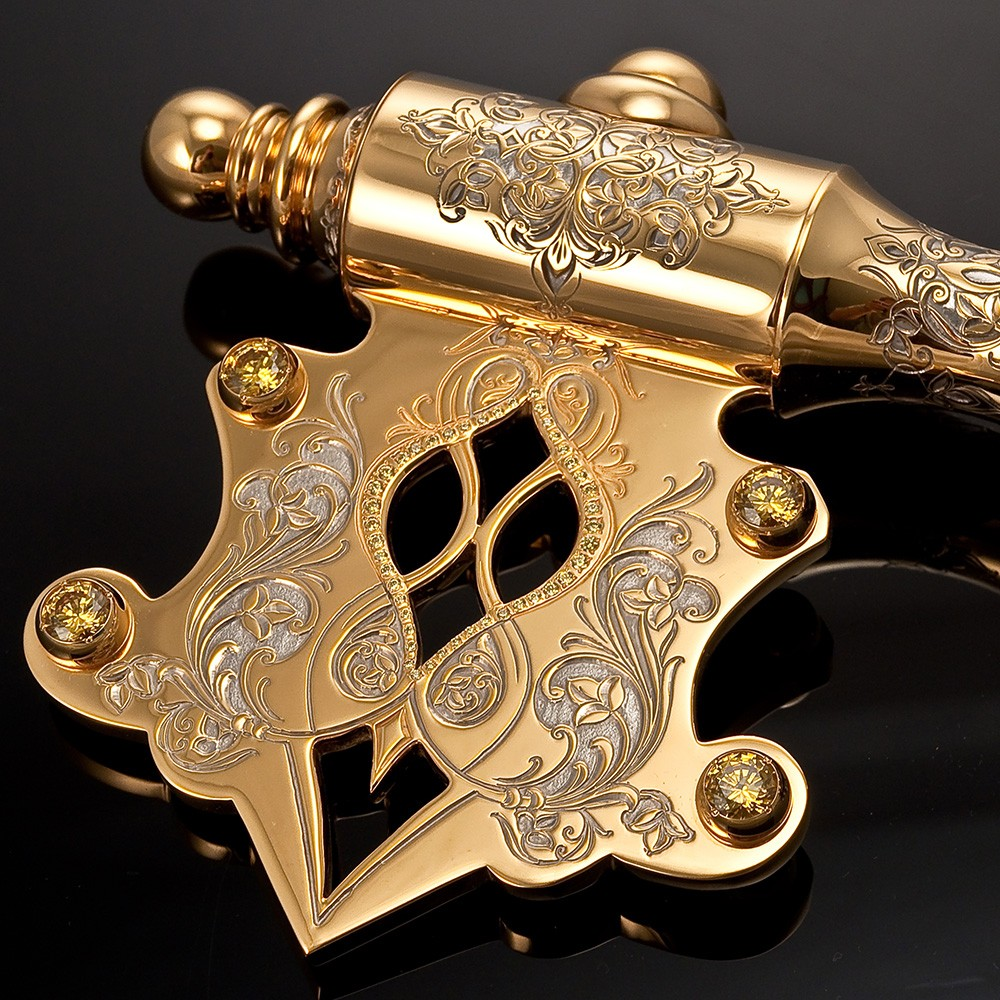Golden key decorated with yellow crystals