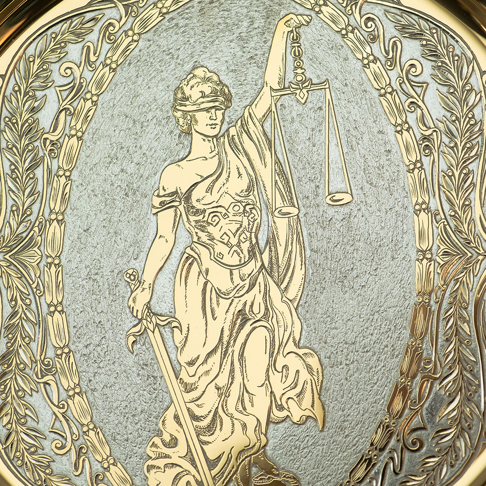 Golden image of the goddess of justice. Zlatoust engraving on metal