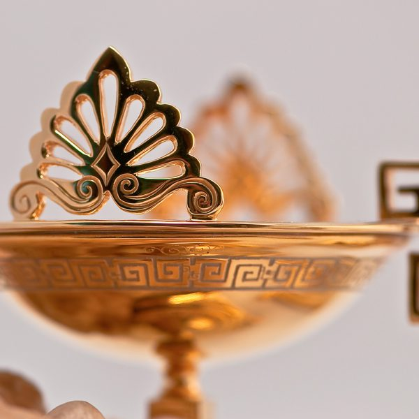 Golden candelabra in Greek style