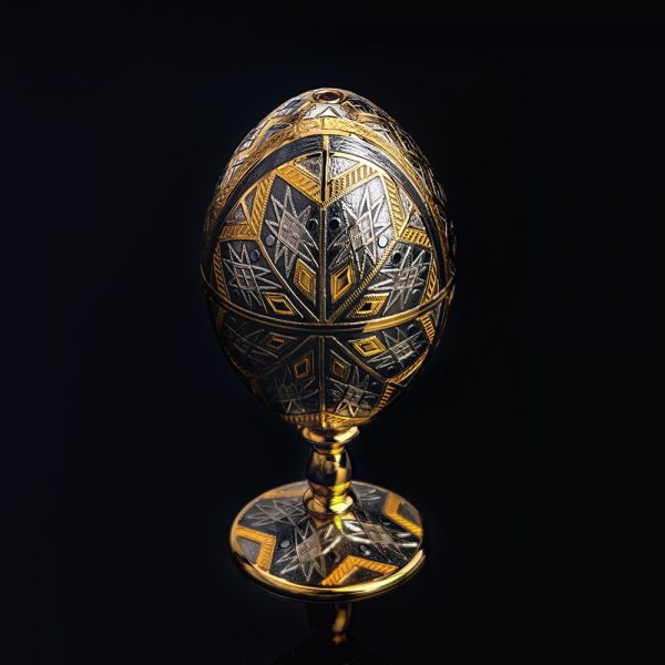 Luxurious jewelry egg on the leg. Decorated with original ornament and rhodium-plated. Platinum group metal.