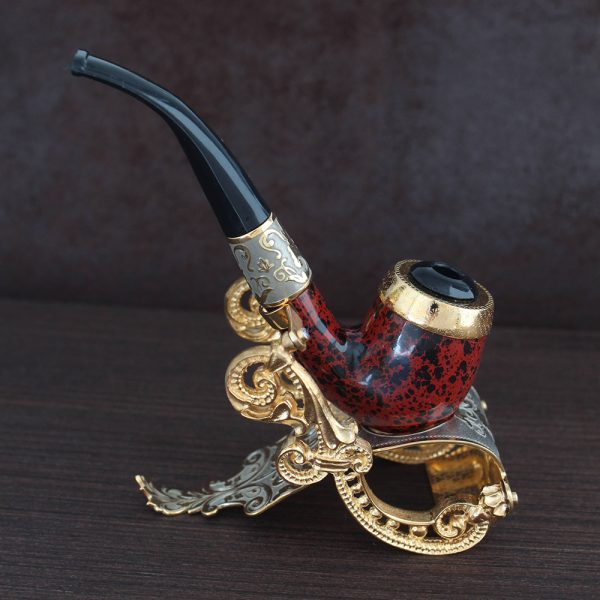 Exclusive manual smoking pipe on a gold stand. A great gift option for a connoisseur of tobacco.