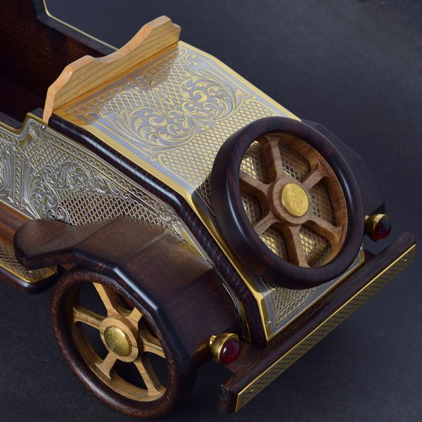 A large model of a retro car to indicate the interior of your office or home. Handwork of Zlatoust masters.