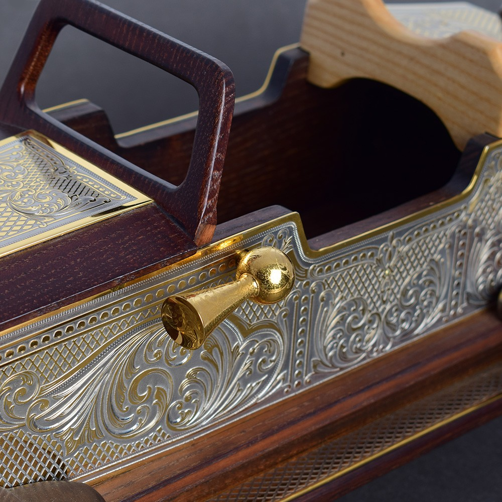 Wooden car model decorated with metal trim. The surface of the pads is indicated by hand engraving using a cutter and a microscope. All metal elements are gold plated.