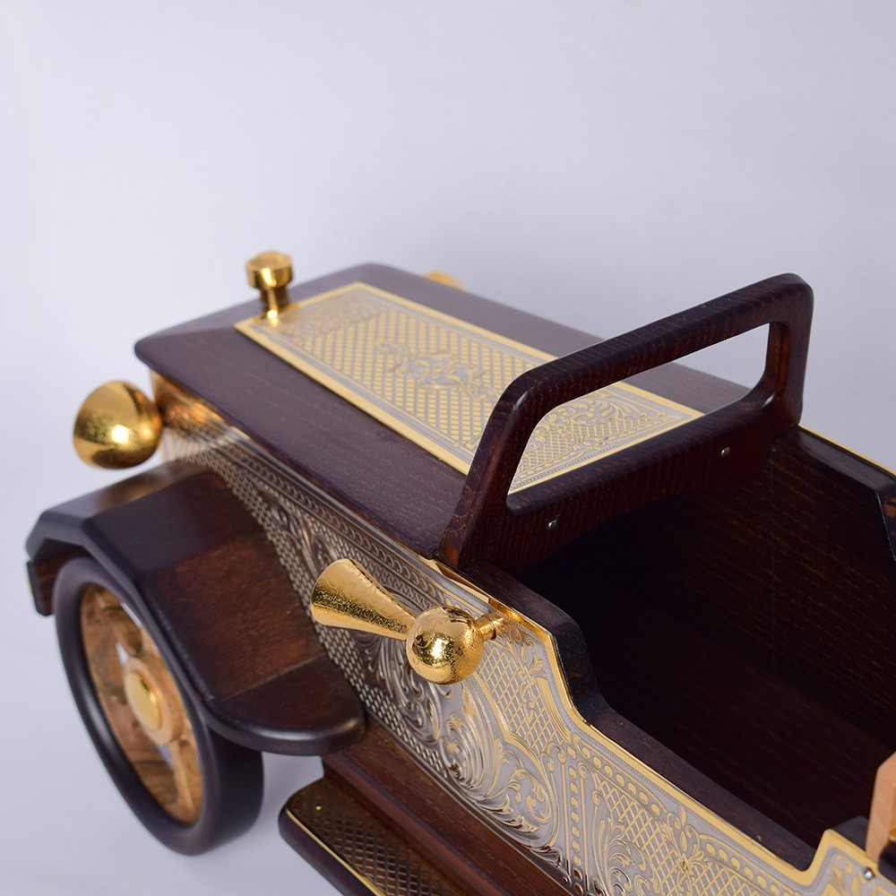 Exclusive interior item - wooden car model covered with gold