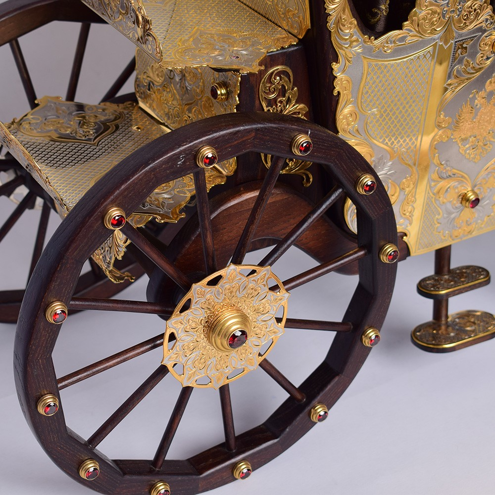 Wooden carriage wheels with inlaid jewelry stones.