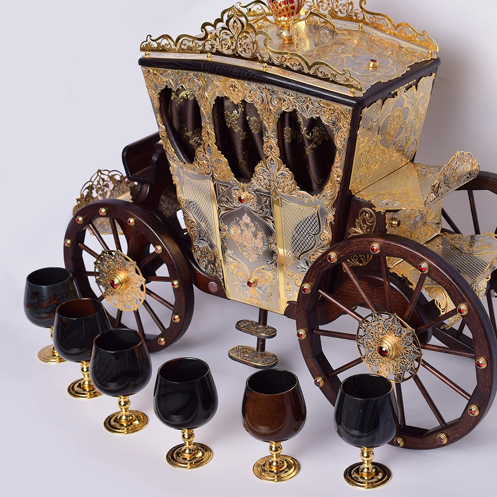 Piece of art. Big golden carriage with stone glasses. A luxurious item for interior design.