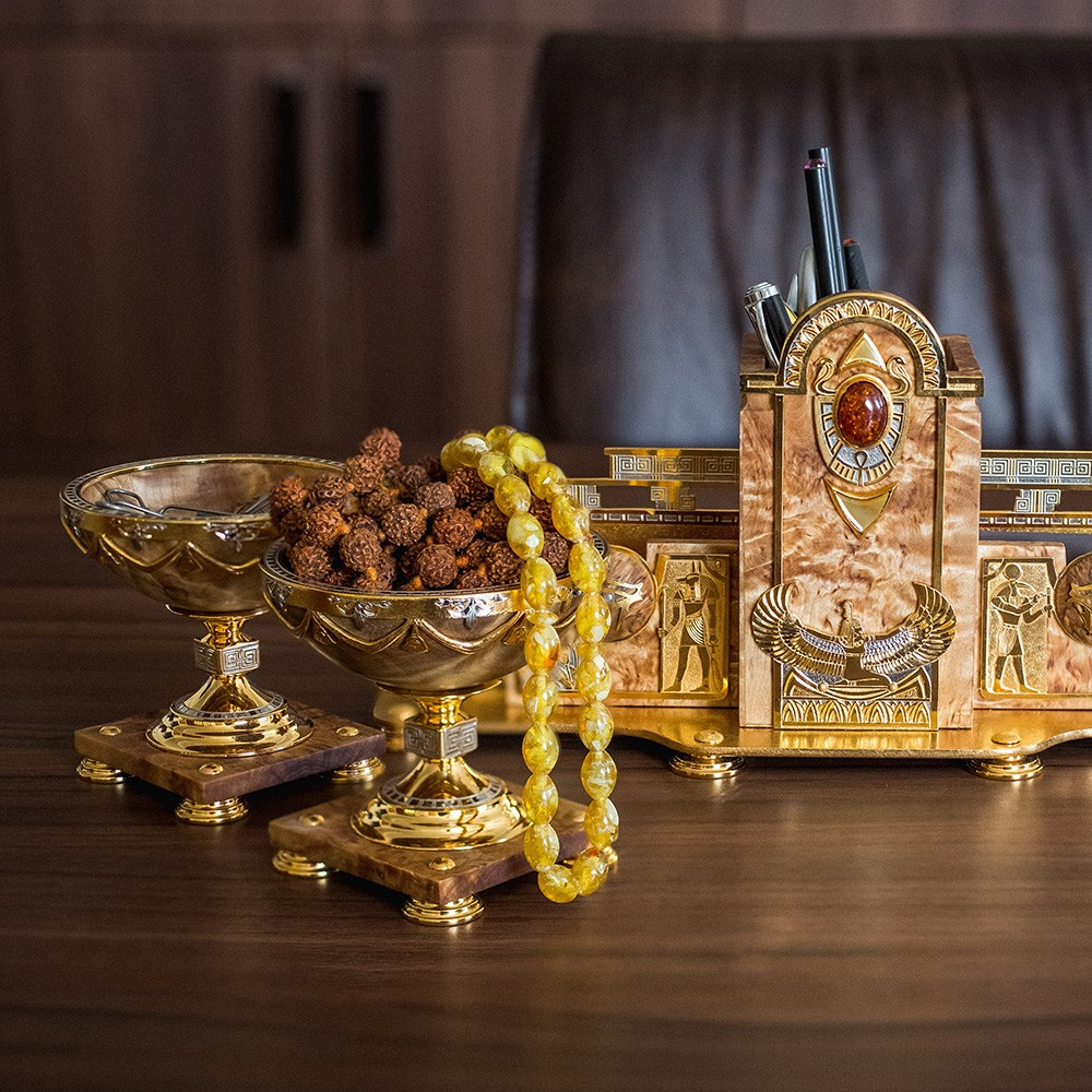 Accessories for stylish design of the presidential office. Functional stationery set made of natural wood, gold and amber.