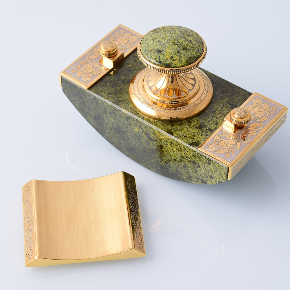 Paperweight press made of natural green stone