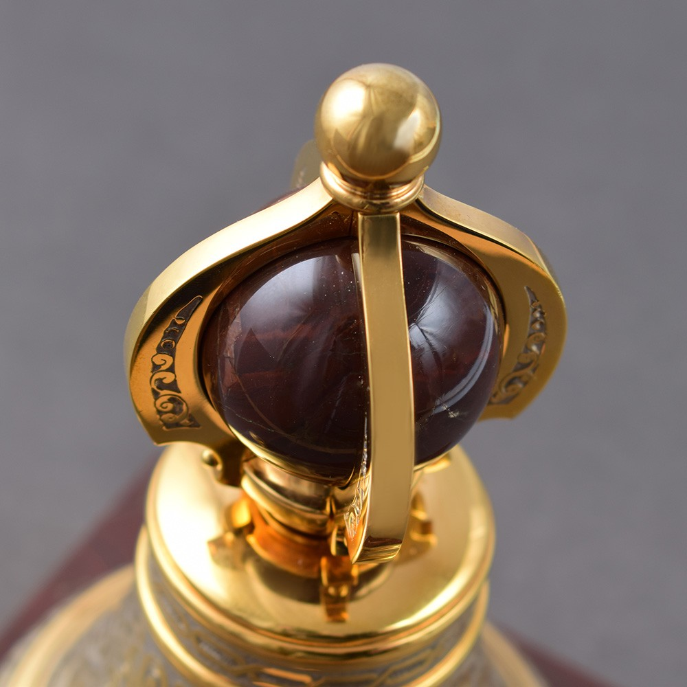 Golden bell with a stone ball