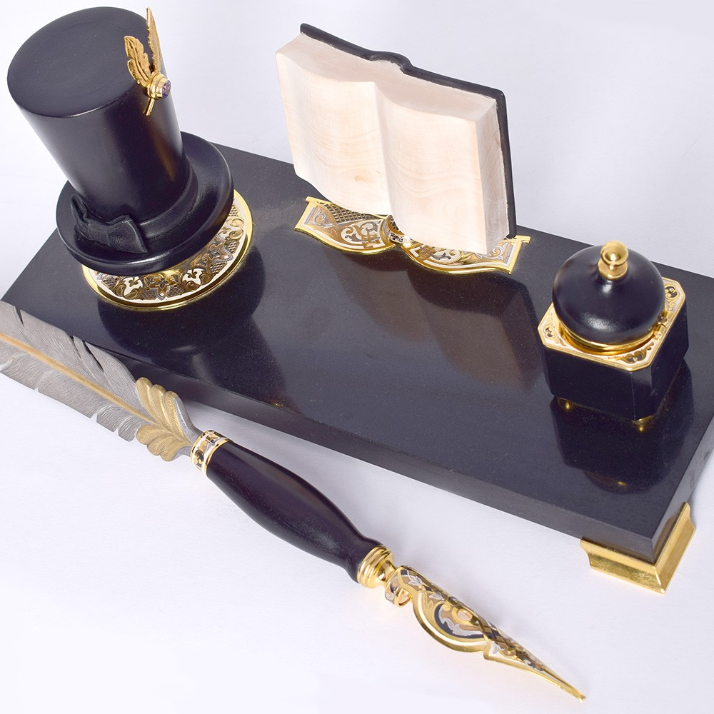 Gift Writing Set Writer. The kit includes a base with an inkwell, a black cylinder serving as a stand for a luxurious handmade pen.