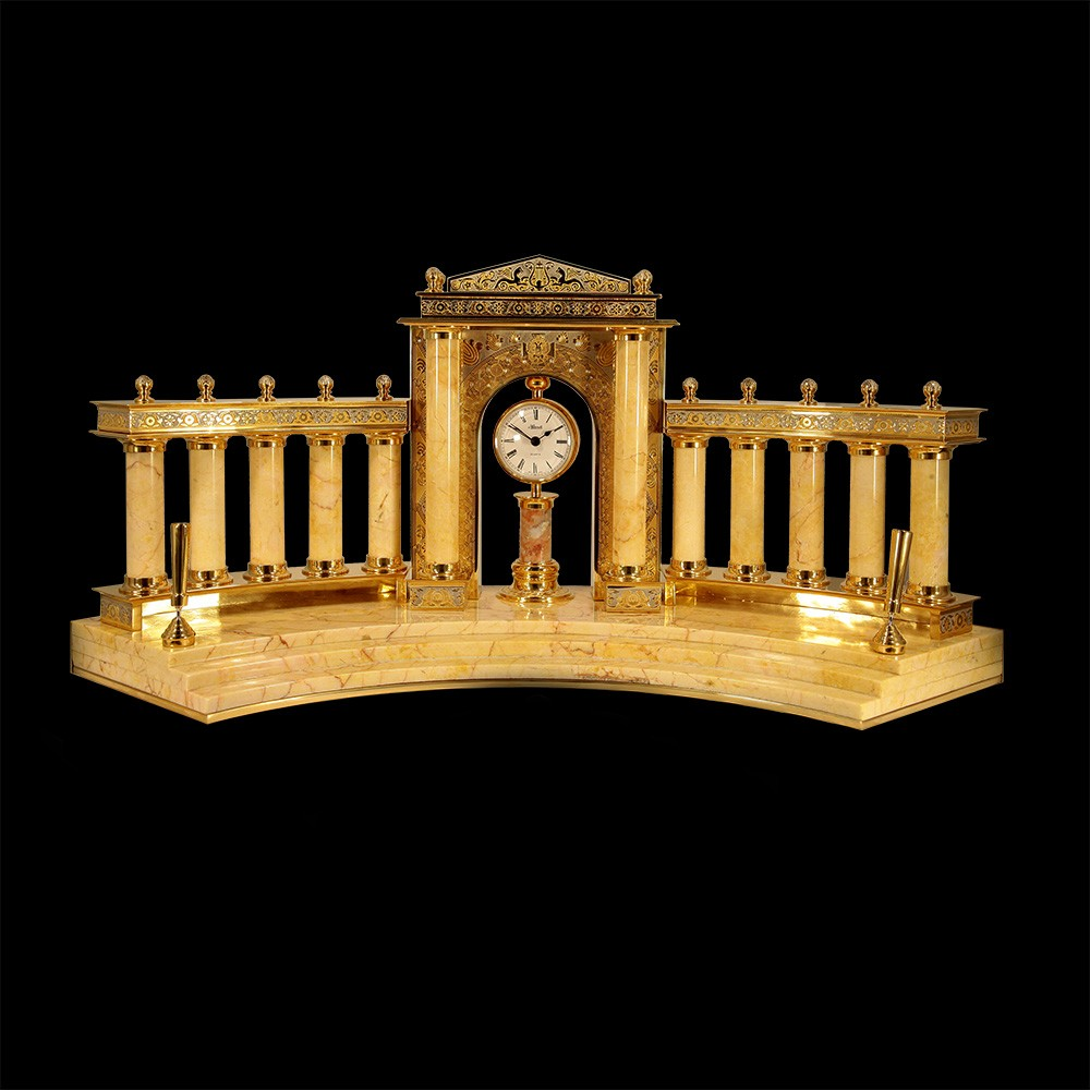 Large writing set made of marble - Colosseum. It consists of massive columns and a round clock under the arch. Handwork of Zlatoust stone-cutting masters and artists
