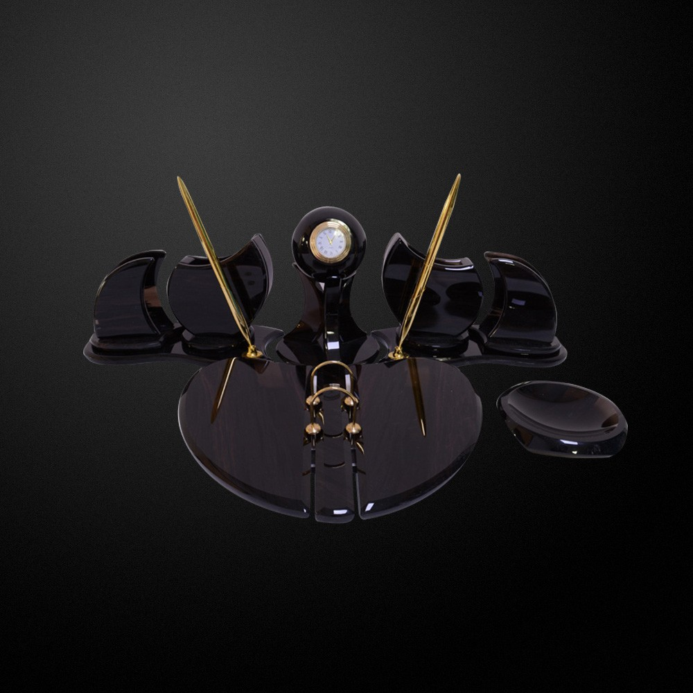 Stylish desk set made of natural obsidian. The watch is enclosed in a stone ball.