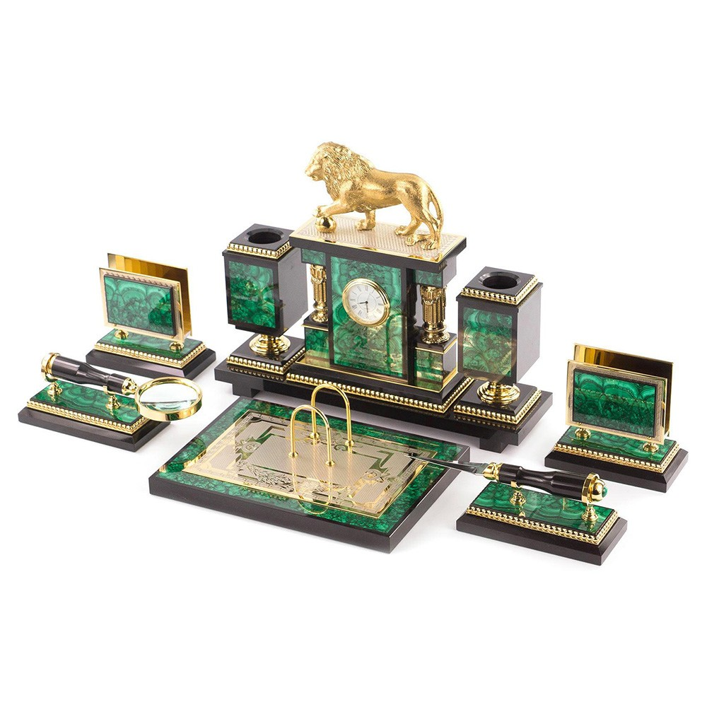A writing set for a study. The set includes six elements. The main building with a clock, pencils and a golden lion. Two business card holders, desk calendar and magnifier with a knife