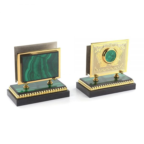 Business card holders are carved by the master from stone. Metal surfaces coated with gold and relief engraving