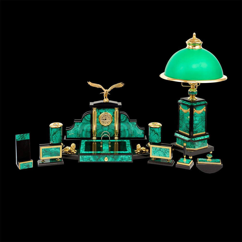 A large functional set for the desktop. The set includes a phone stand, two business card holders, a stand for a pen, paperweight, a table lamp and a large central case with two pencil boxes, a calendar, a clock and a box.