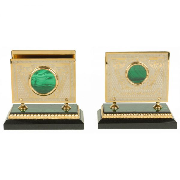 Gold business card holders on a stone base