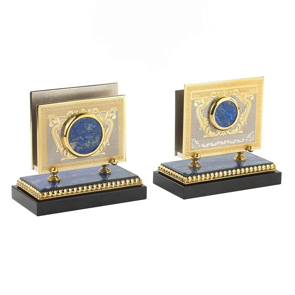 Handmade business card holders made of metal and stone.