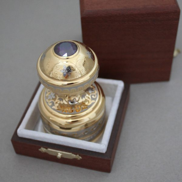 Gold handmade stamp in a wooden box