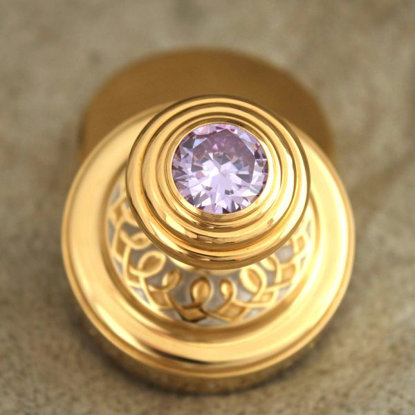 Large cubic zirconia in the hilt of a gold stamp