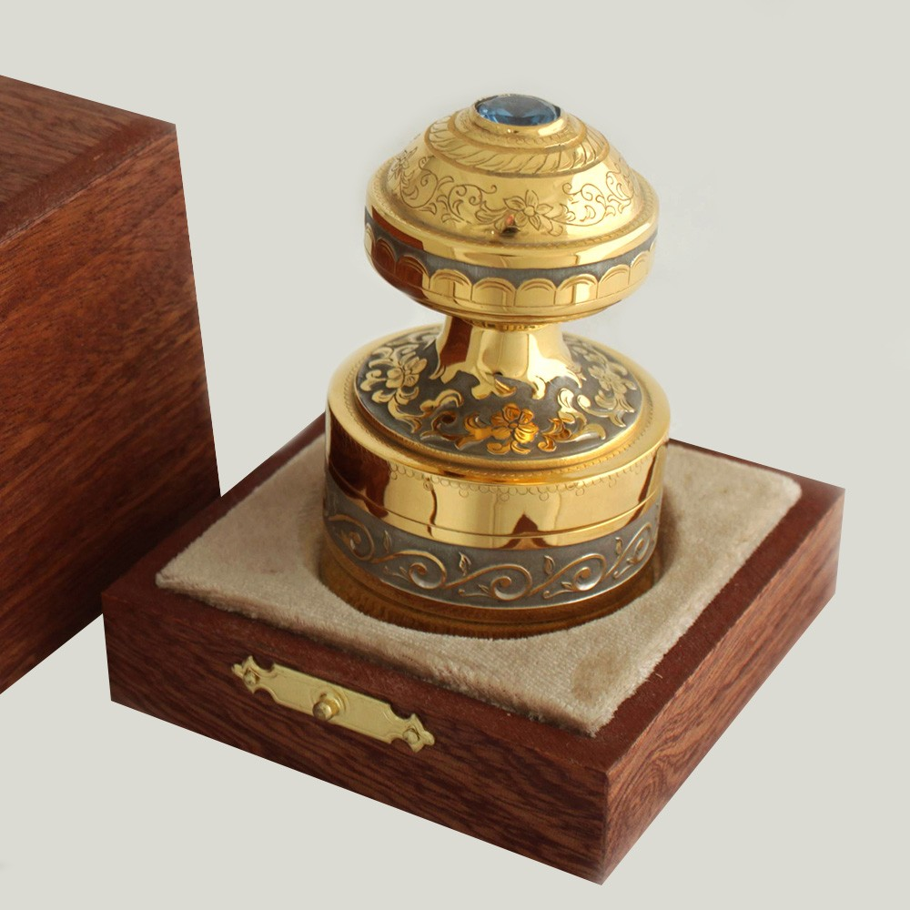 A gold stamp is an element of business style. An accessory for decorating the desktop. A handmade stamp is a find for a person looking for a gift to a chief or colleague.