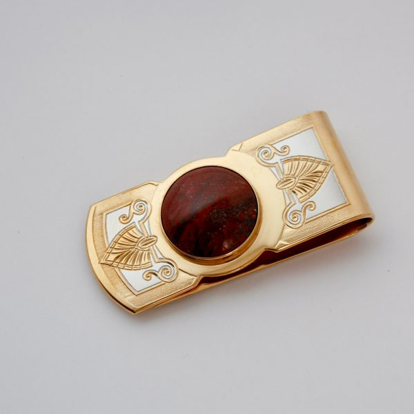 Gold clip decorated with natural stone insert