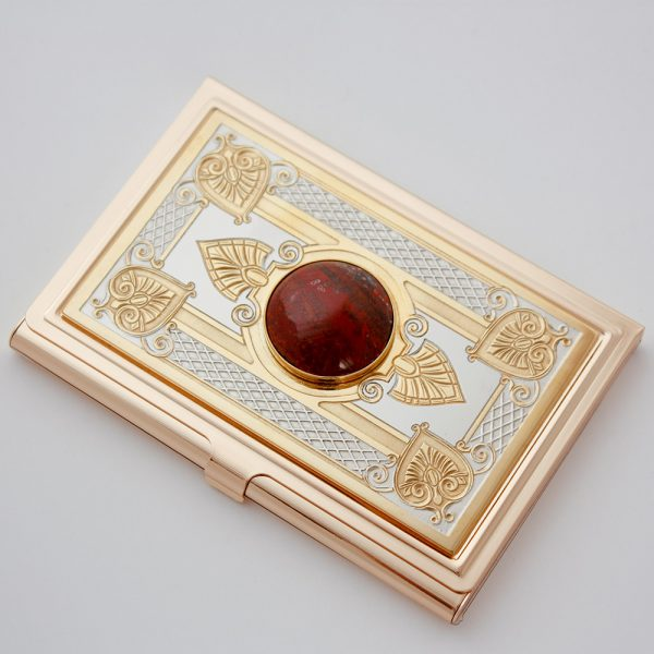 Gold card holder decorated with natural stone